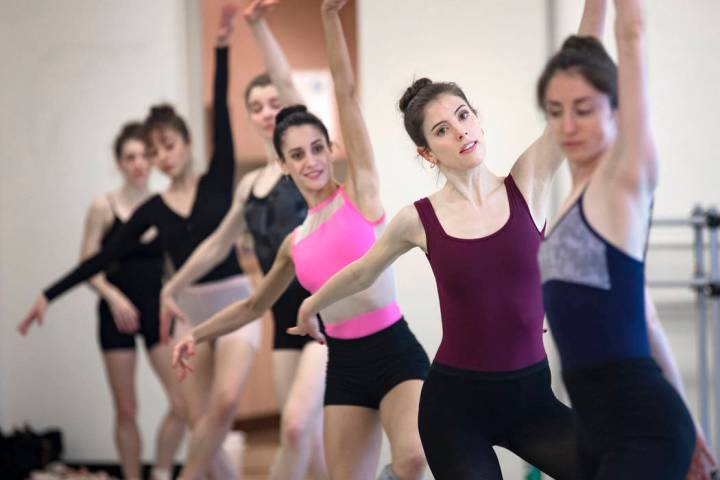 "Katie Zimmerman dances in a line with others during rehearsal for ""The Current,"" an original wo ..."