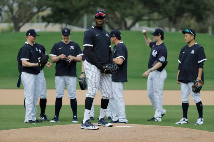 New York Yankees' Aroldis Chapman takes part in drills with teammates during spring training ba ...