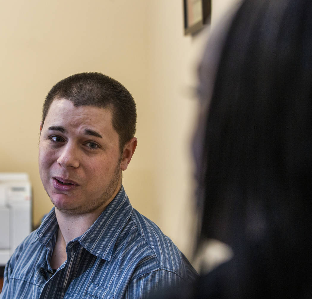 Joshua Domsky talks with counselor Kairo Henderson about the progress he has made as a patient ...