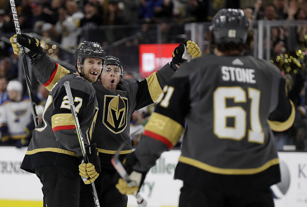 Vegas Golden Knights center Jonathan Marchessault, rear, celebrates after scoring against the S ...