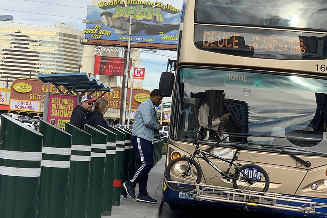 People board a bus on Las Vegas Boulevard near Sahara Avenue in Las Vegas. (Mick Akers/Las Vega ...