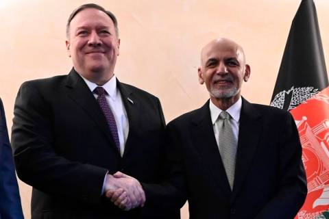 US Secretary of State Mike Pompeo, left, shakes hands with Afghan President Ashraf Ghani,during ...