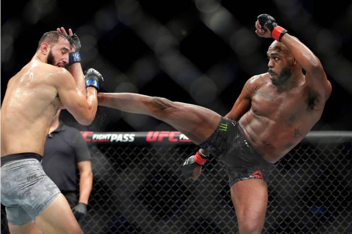 Dominick Reyes, left, and Jon Jones, right, during a light heavyweight mixed martial arts bout ...