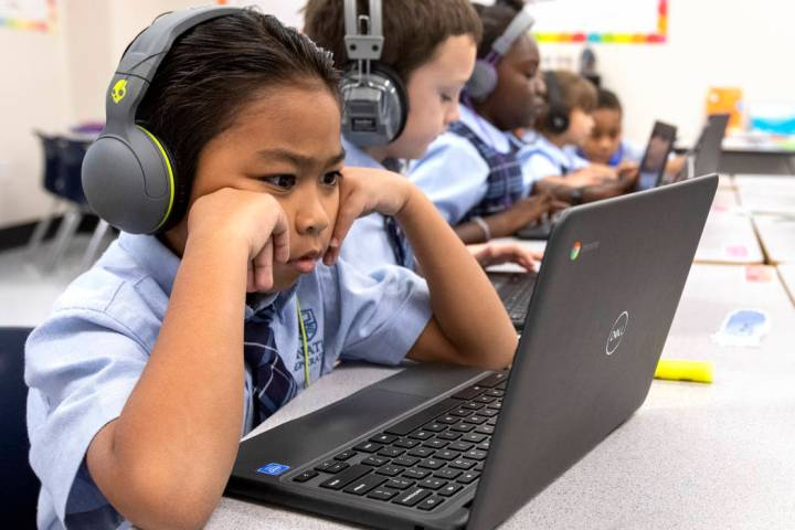 Second grader Anton Casis concentrates on his computer on Wednesday, Oct. 23, 2019, at Signatur ...