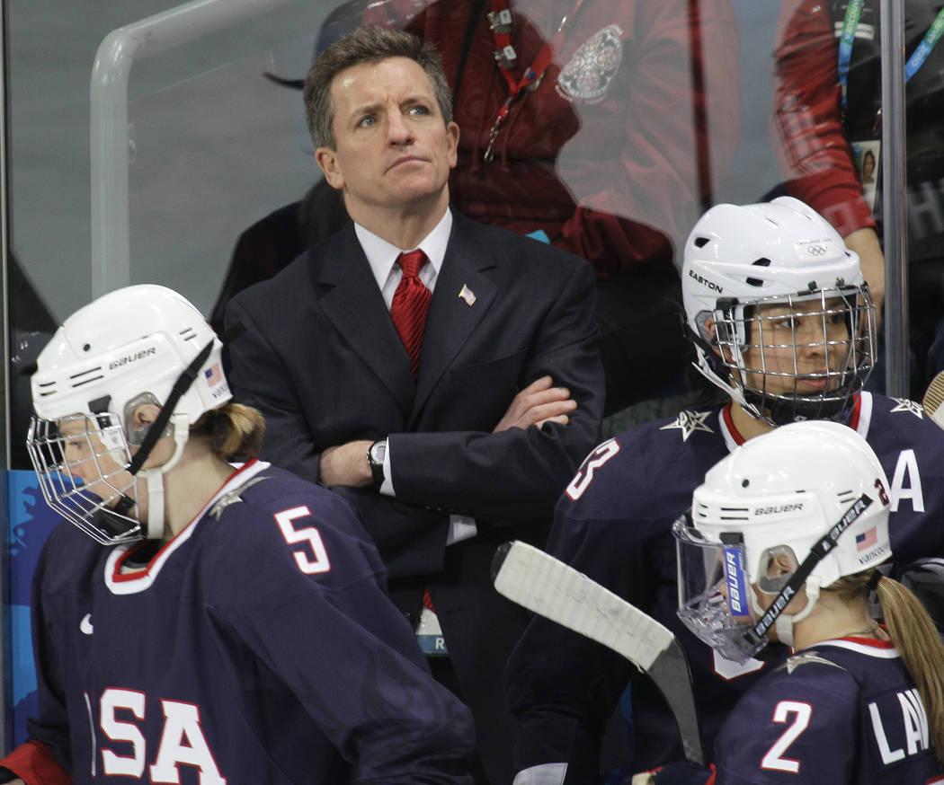 USA women's hockey head coach Mark Johnson watches his team play China in women's preliminary r ...