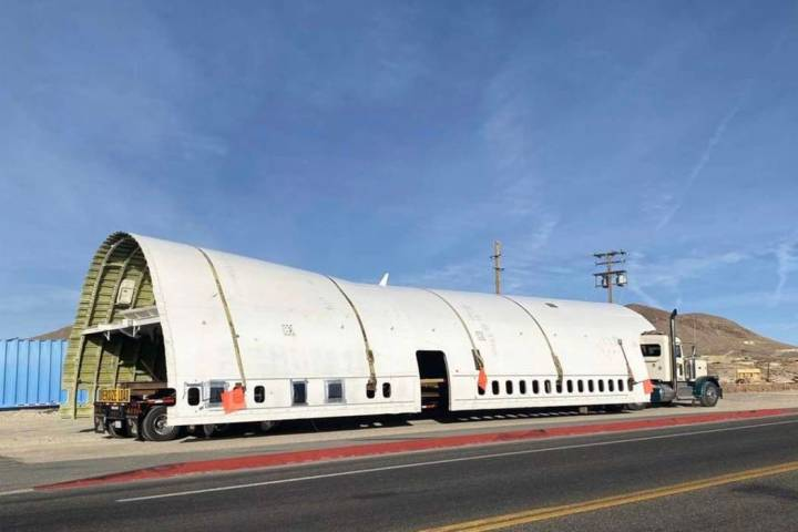Part of the fuselage of a Boeing 747 used in Burning Man makes a pit stop in Tonopah, en route ...