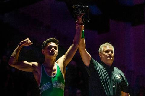 Green Valley's David Kalayanaprapruit is awarded the win over Reed's Alejandro Casarez in their ...