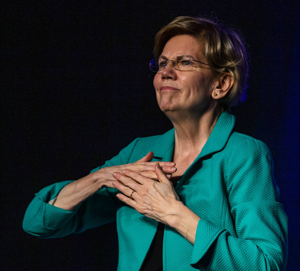 Sen. Elizabeth Warren, D-Mass., is touched by the crowd during the Clark County Democrats Kick ...