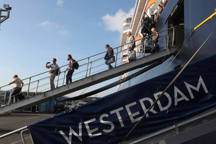 Passengers of the MS Westerdam, owned by Holland America Line disembark from the MS Westerdam, ...