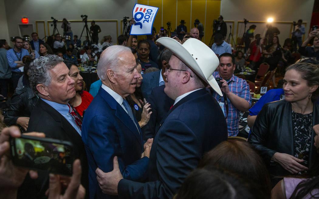 Former Vice President Joe Biden, left, speaks with Andrew Pritt of Warren, Ark., during the Cla ...