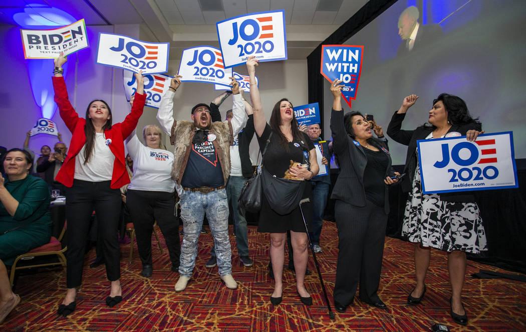 Former Vice President Joe Biden supporters cheer as he speaks during the Clark County Democrats ...