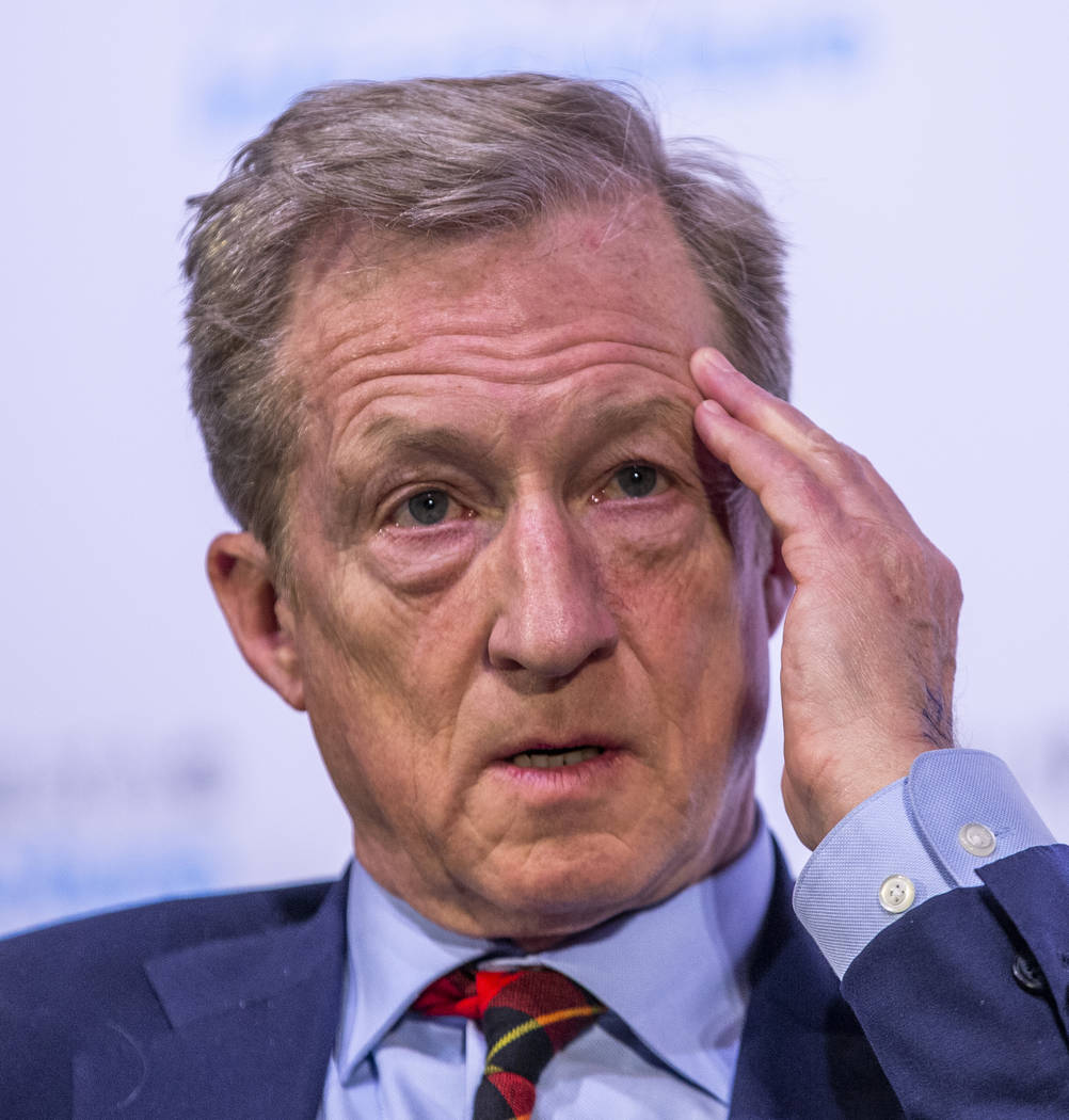 Businessman Tom Steyer, left, considers a response while answering questions from The Wall Stre ...