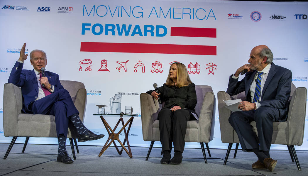 Former Vice President Joe Biden, left, answers questions from The Wall Street Journal's Jeanne ...