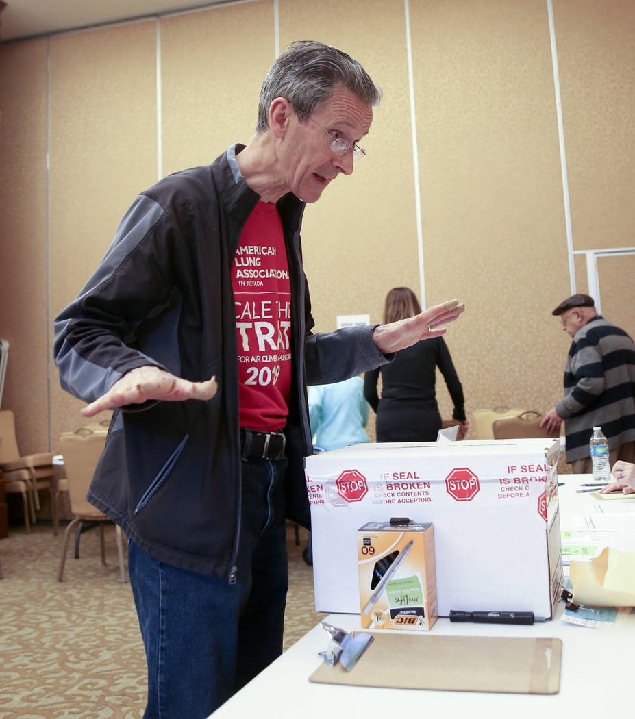 """Anthony Allison, 58, of Las Vegas asks, """"That's it?"""" after dropping his ballot during ..."""
