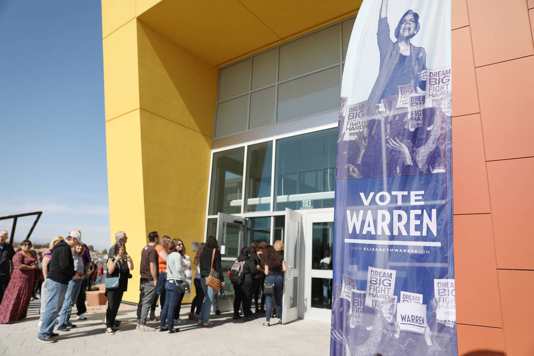 Individuals arrive to hear Sen. Elizabeth Warren speak ahead of a town hall at College of South ...