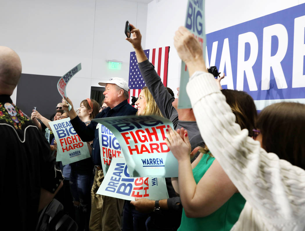 Supporters cheer for Sen. Elizabeth Warren as she speaks ahead of a town hall at College of Sou ...