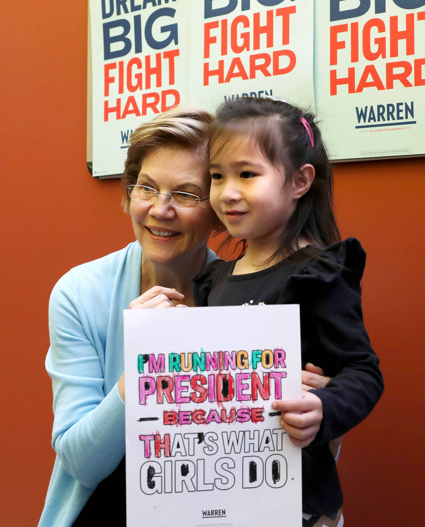 Sen. Elizabeth Warren takes a photograph with Davina Lidikay, 5, at College of Southern Nevada ...