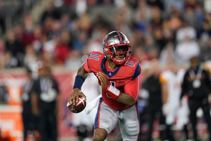 Houston Roughnecks quarterback P.J. Walker (11) looks to pass as he scrambles during an XFL foo ...