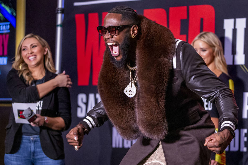 WBC heavyweight title fighter Deontay Wilder yells for the crowd while on stage during the Gran ...