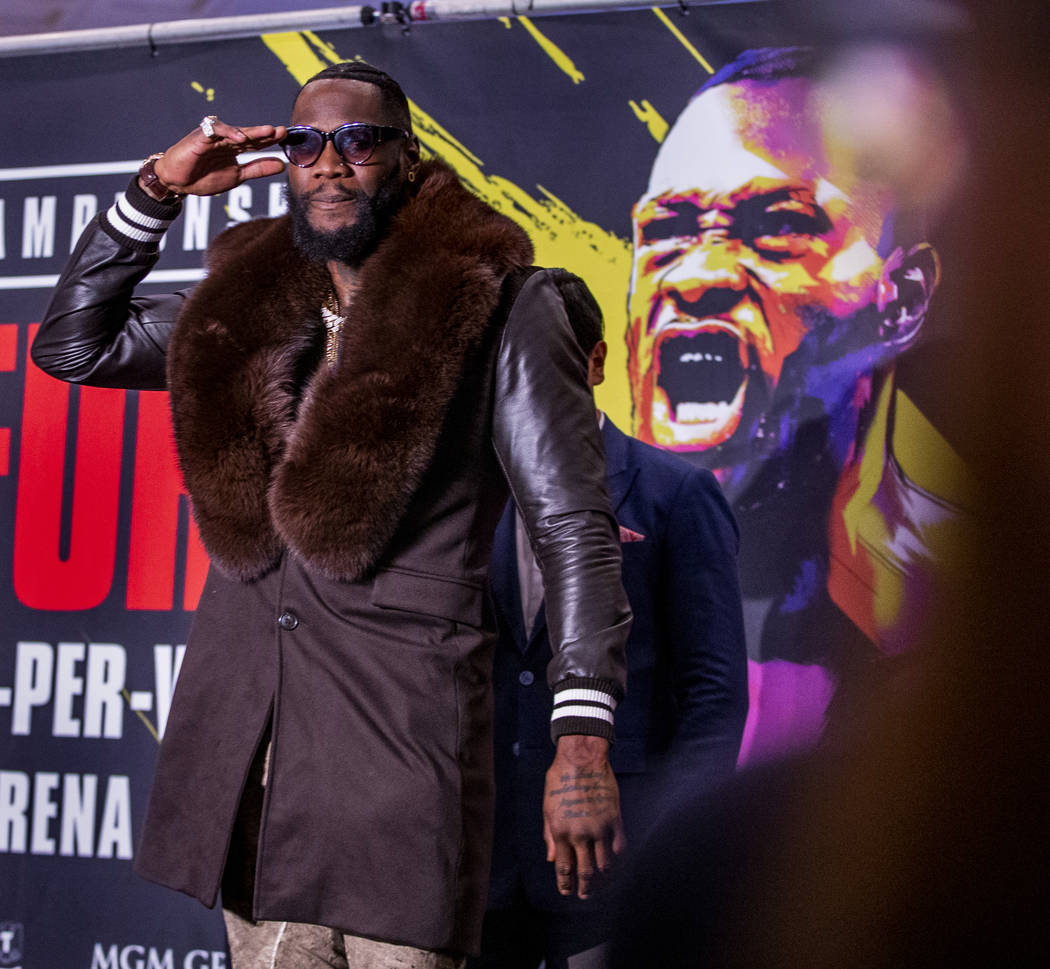 WBC heavyweight title fighter Deontay Wilder salutes the crowd on stage during the Grand Arriva ...
