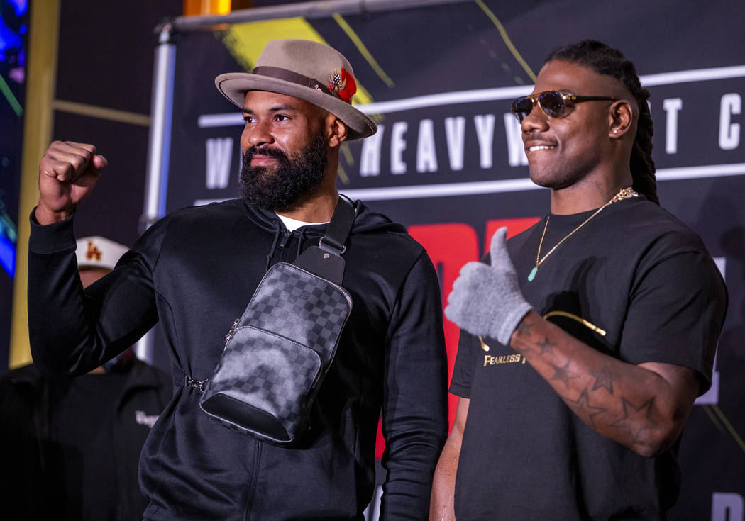 Heavyweight's Gerald Washington, left, and Charles Martin pose on the stage during the Grand Ar ...