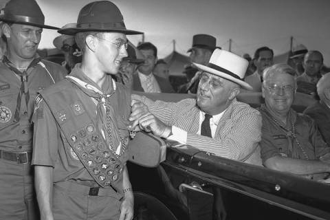 In this July 8, 1937 file photo, President Franklin D. Roosevelt stops briefly to pin an Eagle ...