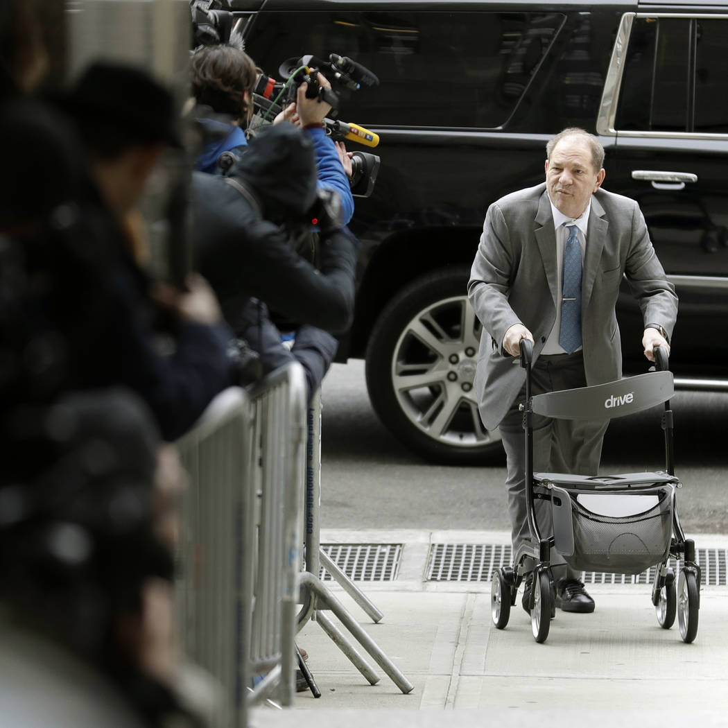 Harvey Weinstein talks to reporters as he arrives at a Manhattan courthouse for his rape trial ...