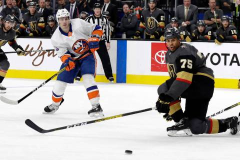 New York Islanders forward Mathew Barzal (13) watches his shot as Vegas Golden Knights right wi ...