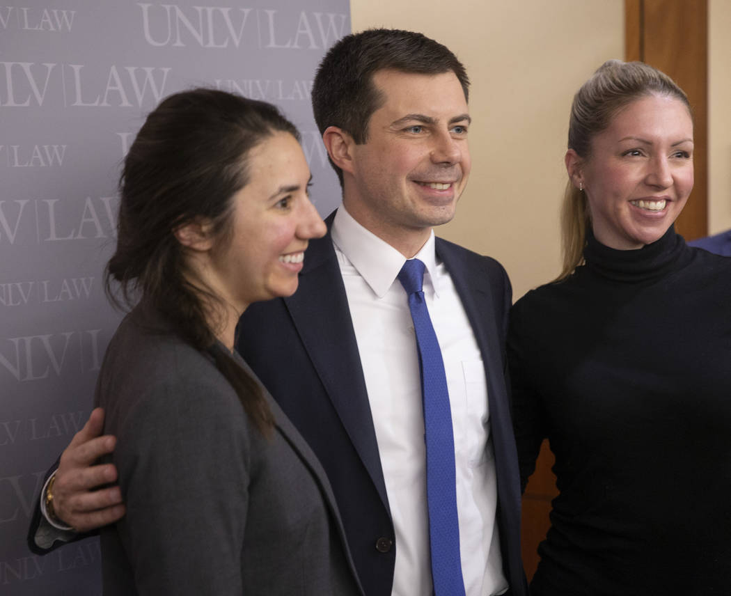 Democratic presidential candidate former South Bend Mayor Pete Buttigieg, middle, takes photos ...