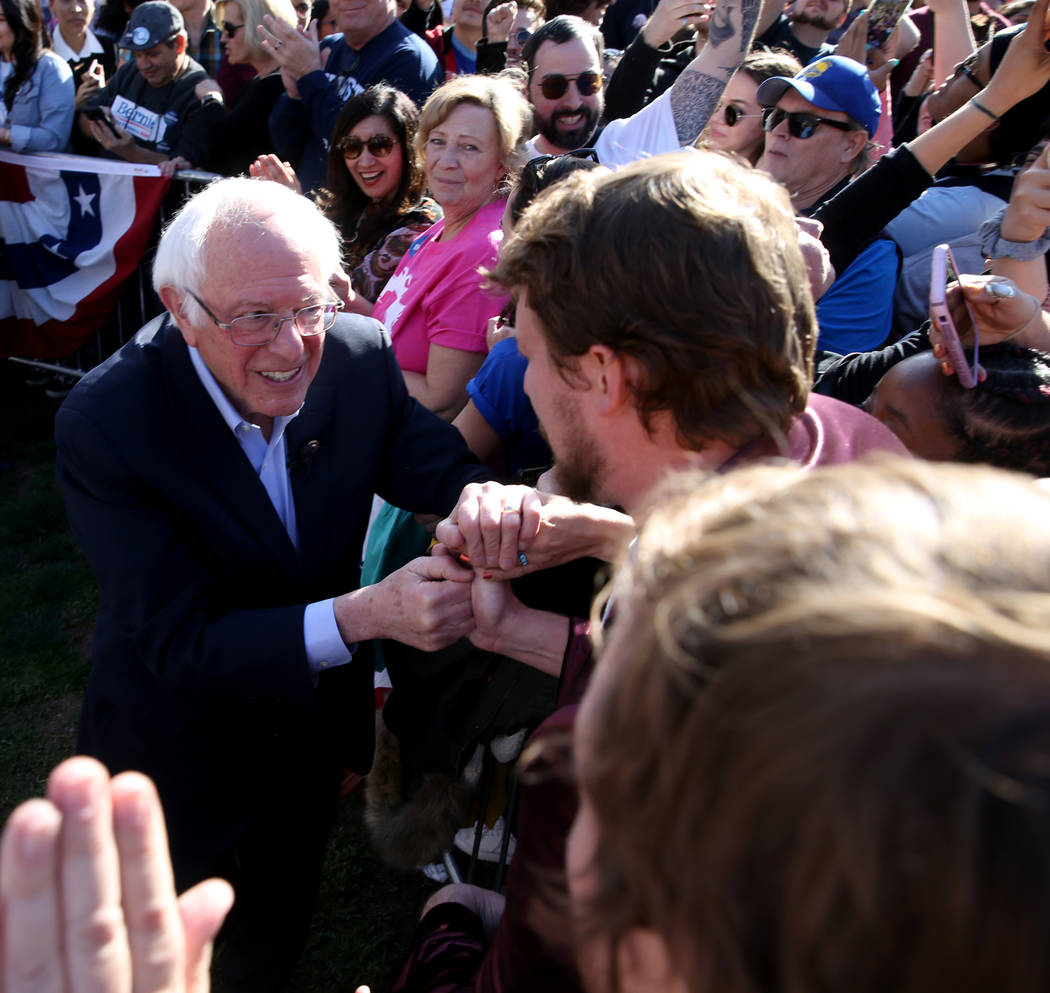 Vermont Sen. Bernie Sanders shakes hands with Brian Maxwell, 26, of Fort Collins, Colo. during ...