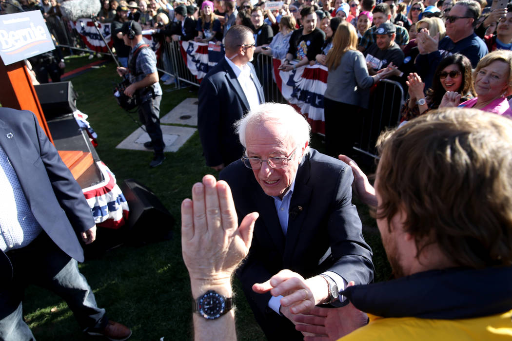 Vermont Sen. Bernie Sanders shakes hands with Brady Maxwell, 26, of Fort Collins, Colo. during ...