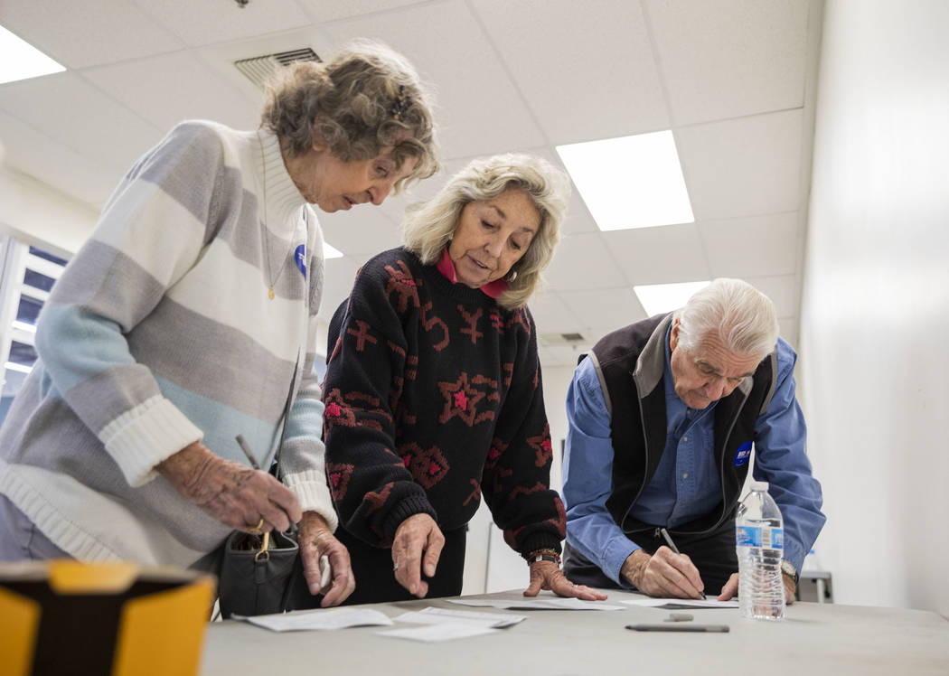 Elizabeth Titus, left, and Rep. Dina Titus, D-Nev., center and husband Thomas Wright cast their ...