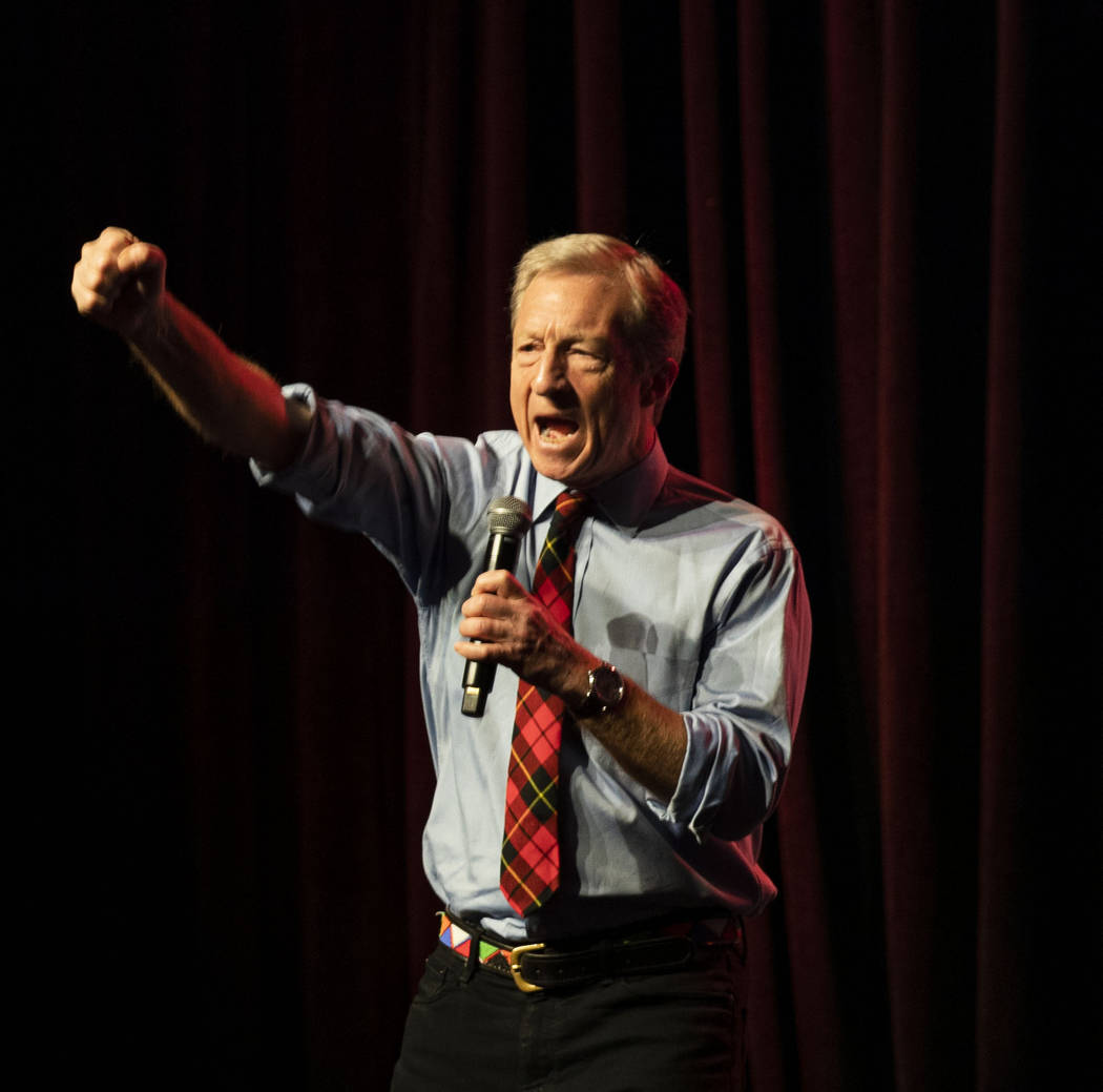 "Democratic presidential candidate Tom Steyer leads a chant stating ""we demand justice,&quo ..."