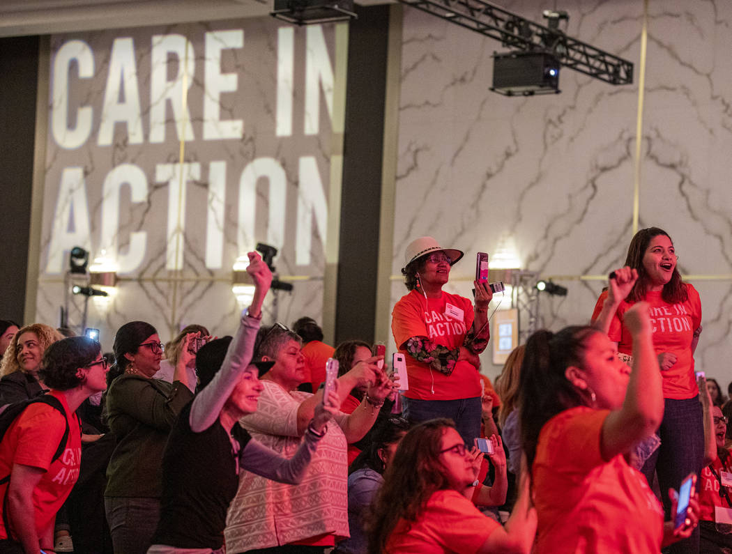 Individuals clap as Sen. Elizabeth Warren speaks during a Care in Action Domestic Worker meetin ...