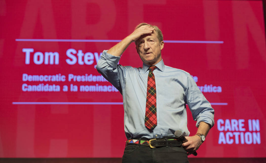 Democratic presidential candidate Tom Steyer listens as a question is presented during a Care i ...