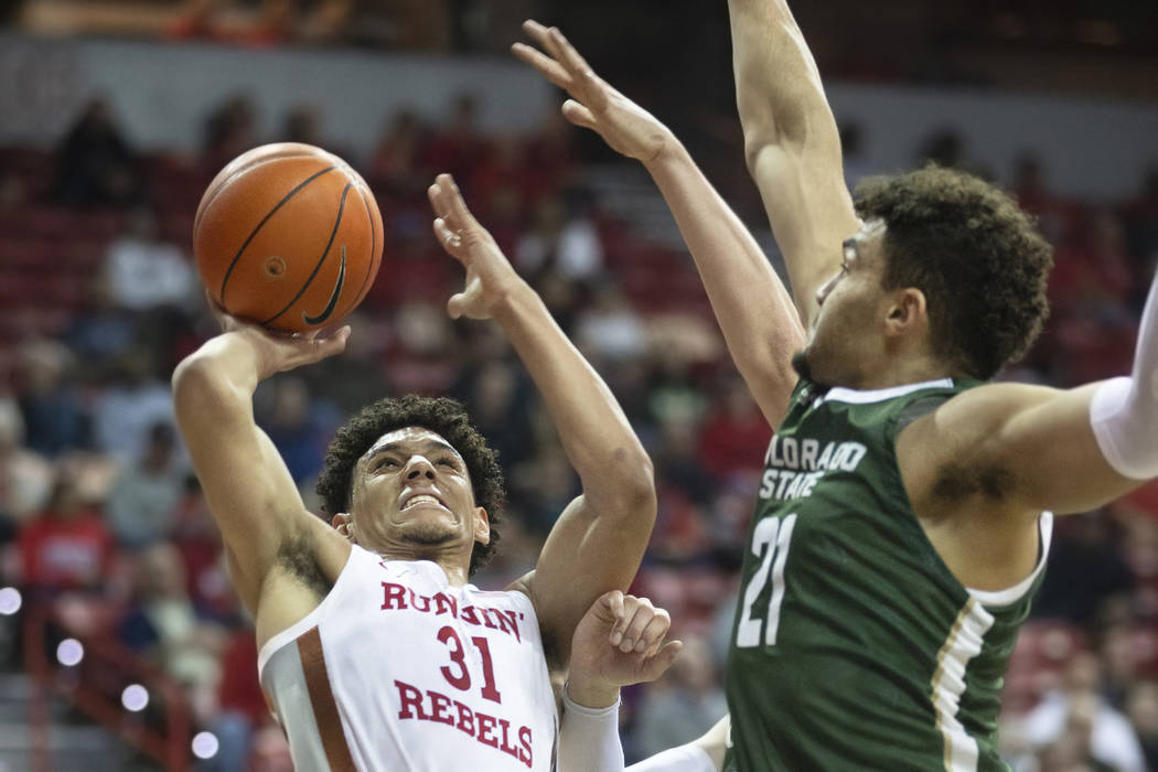 UNLV Rebels guard Marvin Coleman (31) drives past Colorado State Rams guard David Roddy (21) in ...