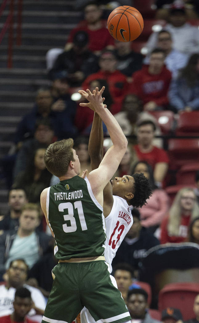 UNLV Rebels guard Bryce Hamilton (13) contests the shot of Colorado State Rams forward Adam Thi ...