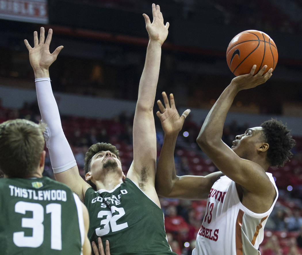 UNLV Rebels guard Bryce Hamilton (13) shoots over Colorado State Rams forward Adam Thistlewood ...