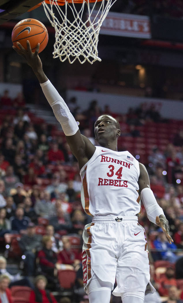 UNLV Rebels forward Cheikh Mbacke Diong (34) converts a fast break layup in the first half duri ...