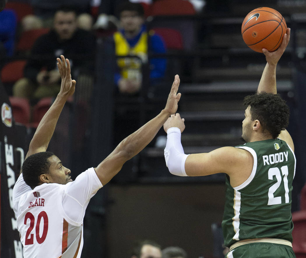 UNLV Rebels forward Nick Blair (20) extends to block the shot of Colorado State Rams guard Davi ...
