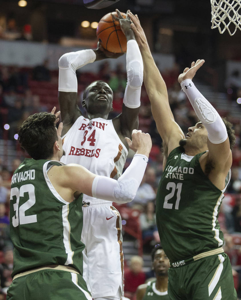 UNLV Rebels forward Cheikh Mbacke Diong (34) shoots over Colorado State Rams center Nico Carvac ...