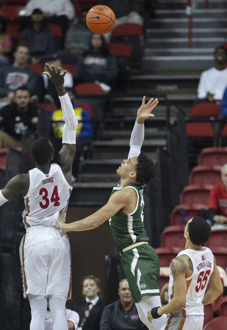 UNLV Rebels forward Cheikh Mbacke Diong (34) reaches to block the shot of Colorado State Rams g ...