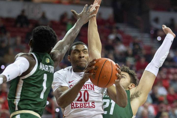 UNLV Rebels forward Nick Blair (20) drives past Colorado State Rams guard Kris Martin (1) and C ...