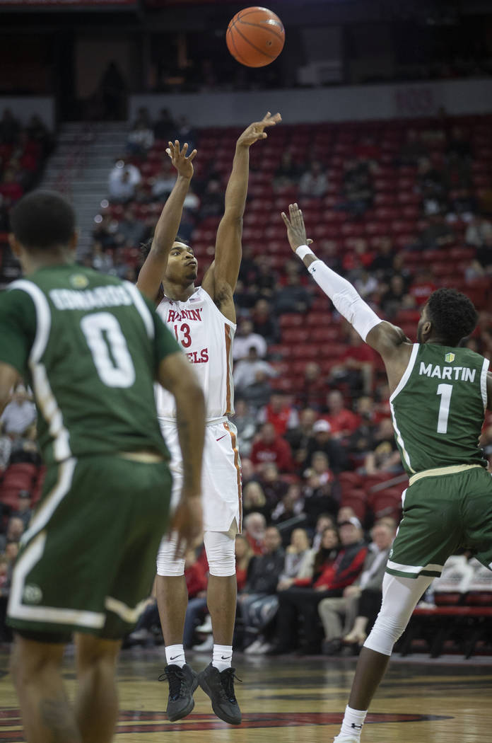UNLV Rebels guard Bryce Hamilton (13) shoots a three point shot over Colorado State Rams guard ...