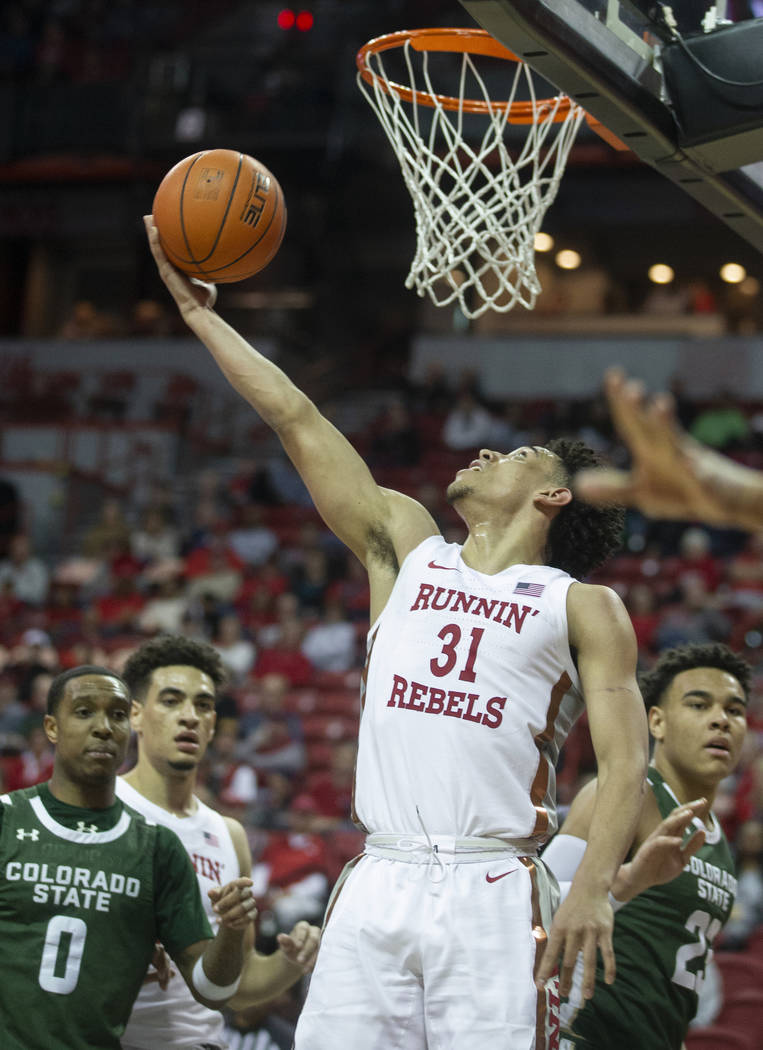 UNLV Rebels guard Marvin Coleman (31) slices to the rim past Colorado State Rams guard Hyron Ed ...
