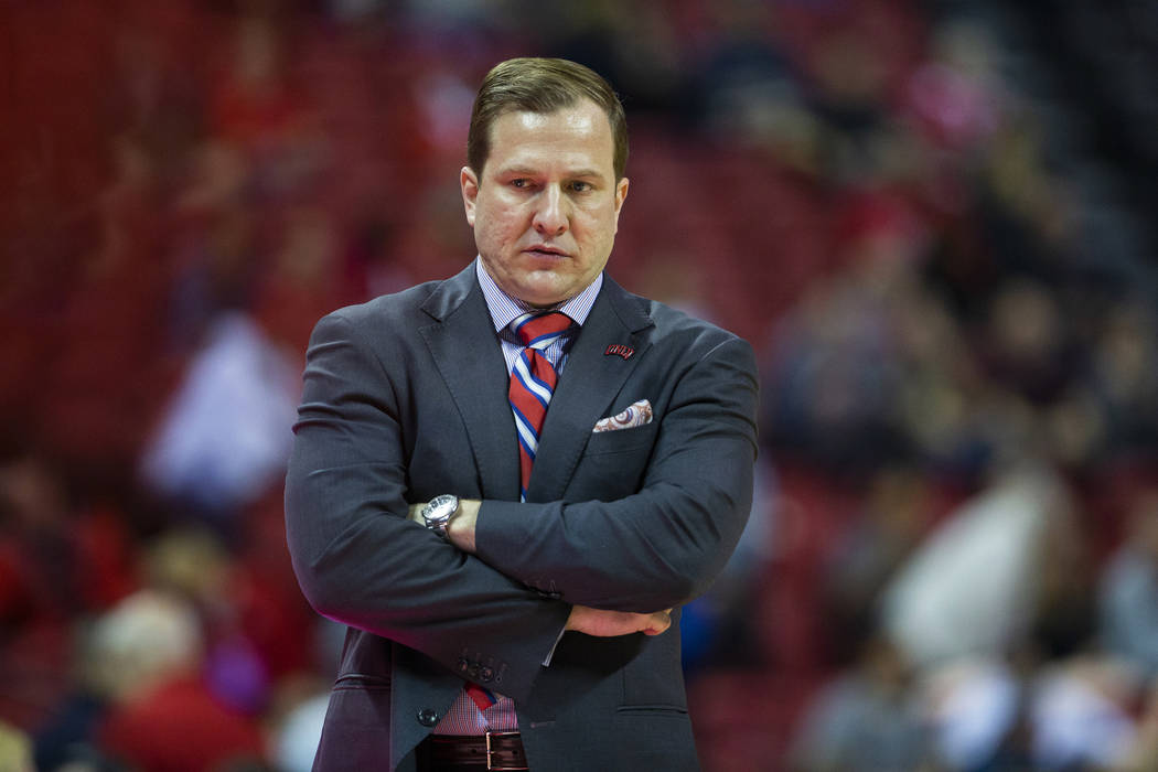 UNLV Rebels head coach T.J. Otzelberger coaches his team in the second half of their NCAA baske ...