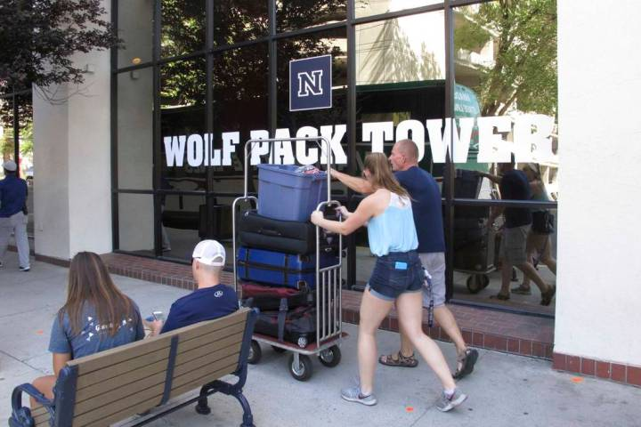 A student moves in to a Circus Circus casino-hotel tower that has been renamed Wolf Pack Tower ...