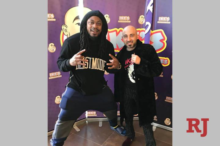 Marshawn Lynch poses with Ike Shehadeh of Ike's Love & Sandwiches. (Ike's Love & Sandwiches)