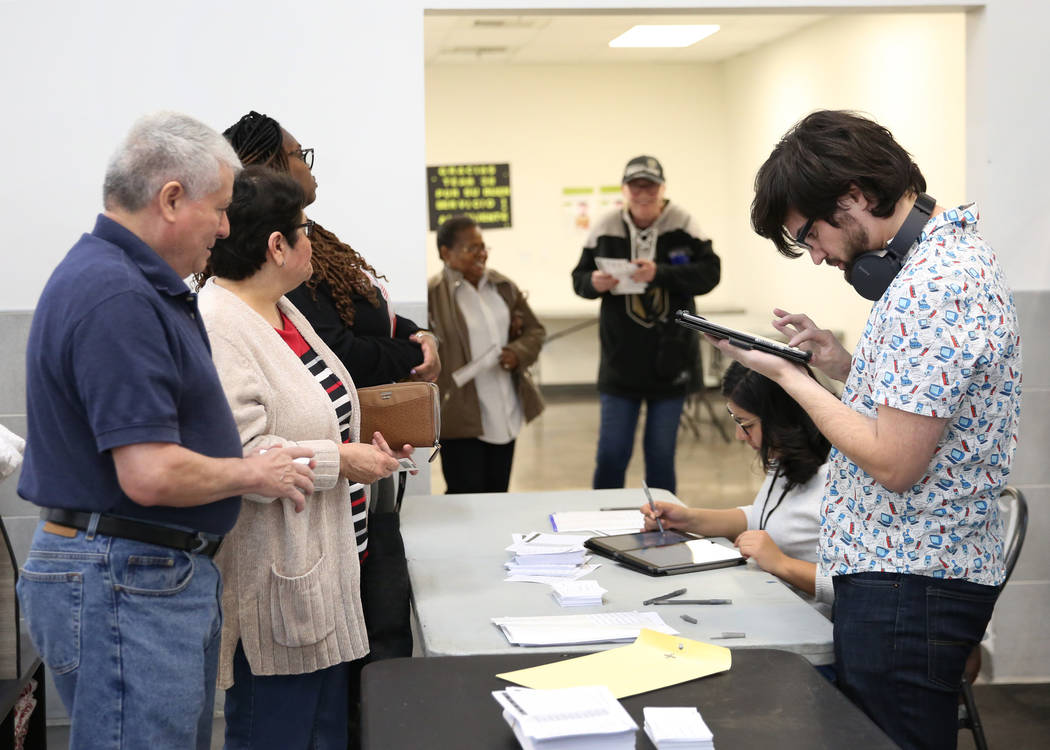 Nation Graca, right, site leader, and Alyssa Cortez, a volunteer, register voters during the la ...
