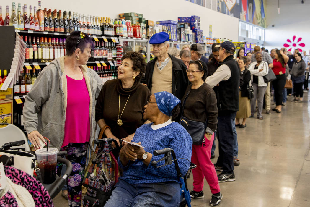 Individuals wait in line to cast their early vote at Cardenas Market in Las Vegas on Tuesday, F ...